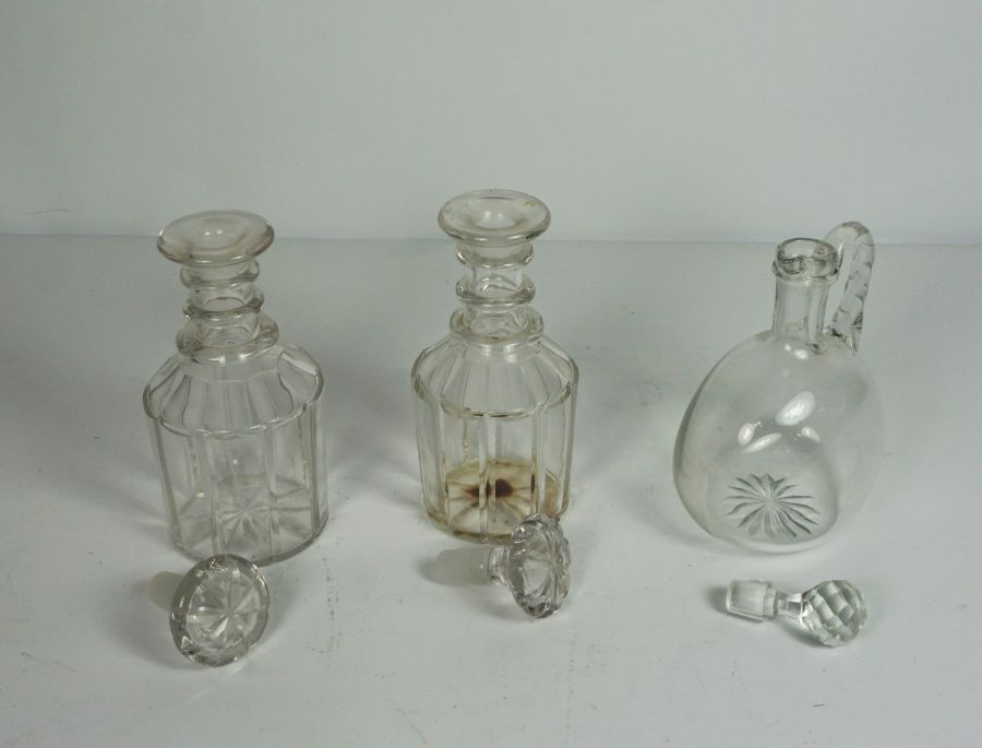 A pair of triple ring neck decanters and stoppers, 19th century, with paneled bodies, and a - Image 2 of 2