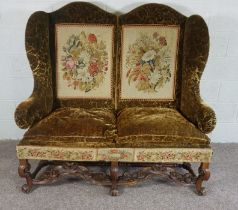 Walnut Framed Wing Back Settee, In Jacobean style, set with tapestry panels, on scroll legs and