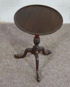 Mahogany Wine Table, In George III style, the circular top on leaf carved tripod base