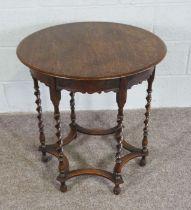 An oak occasional table, Circular top on Barley Twist legs