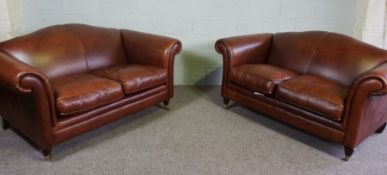 Two Tan Leather Three Seater Sofas with Castor Legs and scroll arms, 170 x 105 x 90 cm
