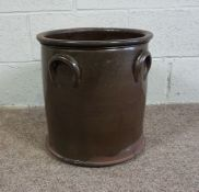 A Brown Glazed Earthenware Pot of cylindrical form with loop handles