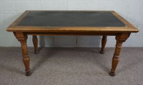 Oak and Pine Center Table, Rectangular top with leather inset panelraised on turned tapered legs