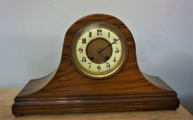Walnut Cased Mantle Clock on domed form with ball feet