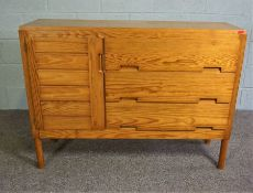Pine cupboard comprising of 3 draws and one sectional cupboard,L 126cms approx.,H 92cms approx.,W