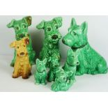 Seven Various Sylvac Green Glazed Dogs and a similar brown glazed example (7)