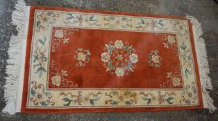 Small Oriental Orange Rug 49cm x 79cm