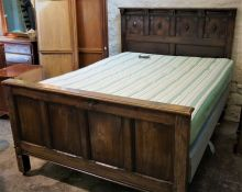 Charles II Style Oak Bed,Decorated with roundels,Raised on metal castors,With side rails,Later