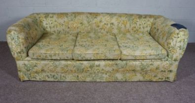 Floral 3 seater Chesterfield sofa with denim patchwork to the right arm.