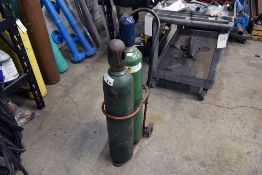 Group of (2) Oxygen Tanks w/ Cart