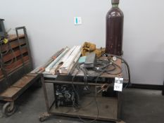 """Miller Econotig CC-AC/DC Arc Welding Power Source w/ 34"""" x 40"""" Rolling Welding Table and SOLD AS IS"""