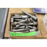 Group of hollow drill bits, various sizes