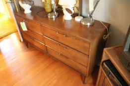 Mirrored dresser fitted with six drawers and a nightstand fitted with single drawer