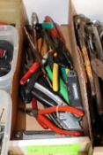 Group of needlenose pliers, Allen key set, and wire cutters