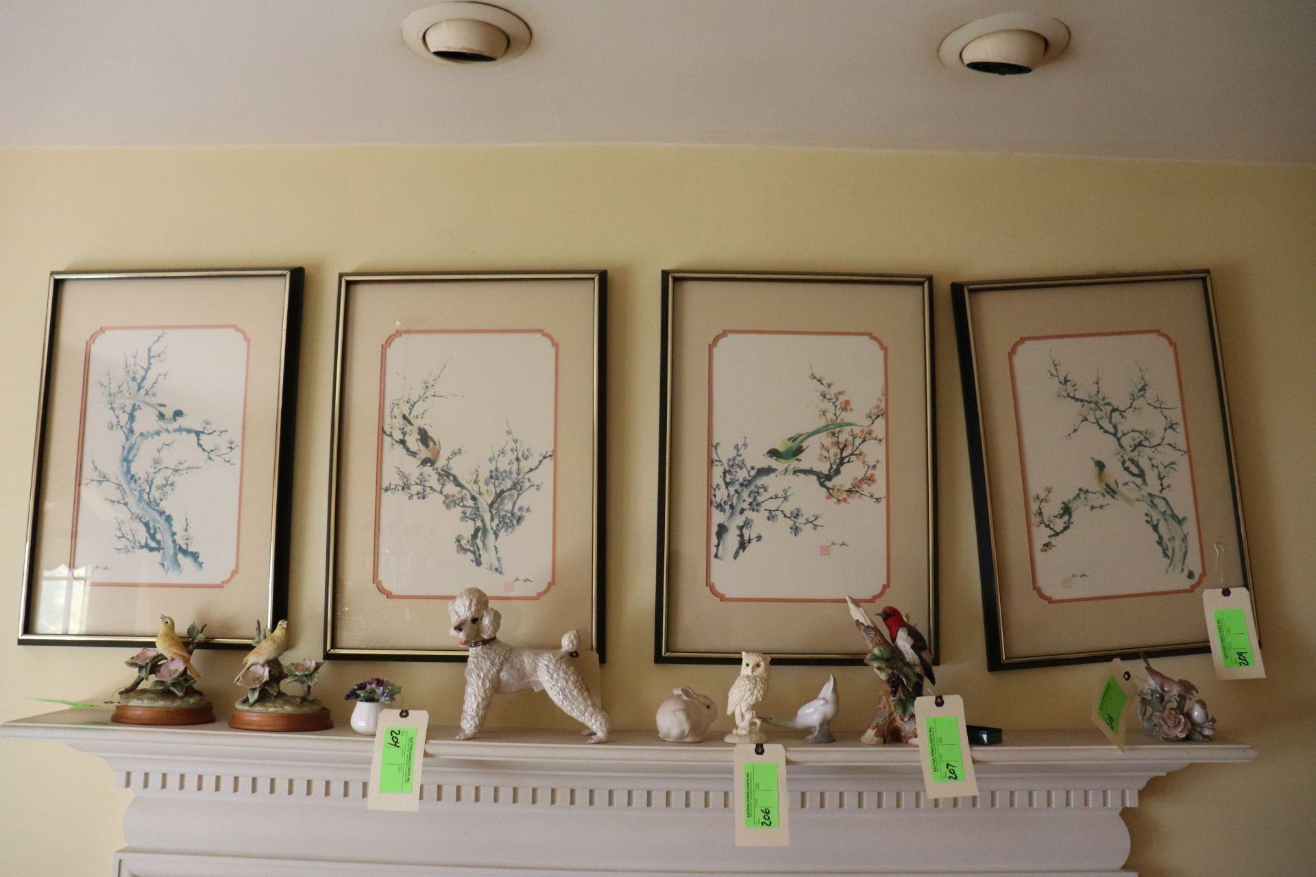 Set of four Asian color screenprints on paper depicting birds and foliage, all matted and framed, ap