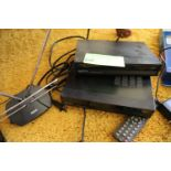 Pair of Apex digital TV converters, model DT250, and an RCA antenna