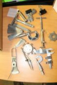 Precision instruments including calipers, right angle caliper, and compass
