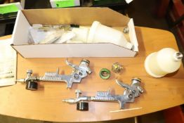 Two Husky paint spray guns with accessories