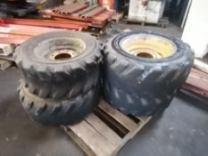(4) Xtra-Wall 12-16.5, 10 P.R Tires with 7 Hole Pattern Rims. Located in Marion, IA.