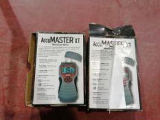(2) AccuMaster XT Moisture Meter. Located in Lincoln, NE.