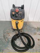 (1) DEWALT D27904 12 Gallon Dust Extractor Vacuum Serial #010056. Located in Mt. Pleasant, IA.