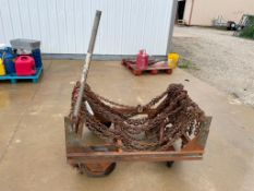 (1) Cart with Chains. Located in Mt. Pleasant, IA.