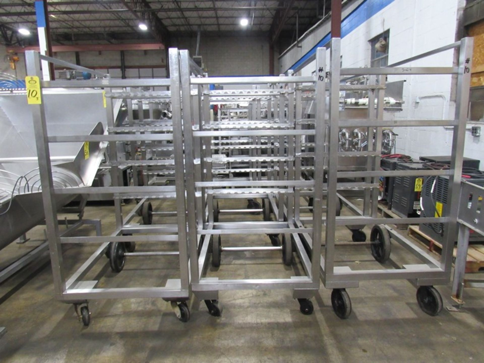 """Stainless Steel Smoke Trucks, 34"""" W X 53 1/2"""" L X 74"""" T, 4 spaces to hold 12, 48"""" sticks spaced"""