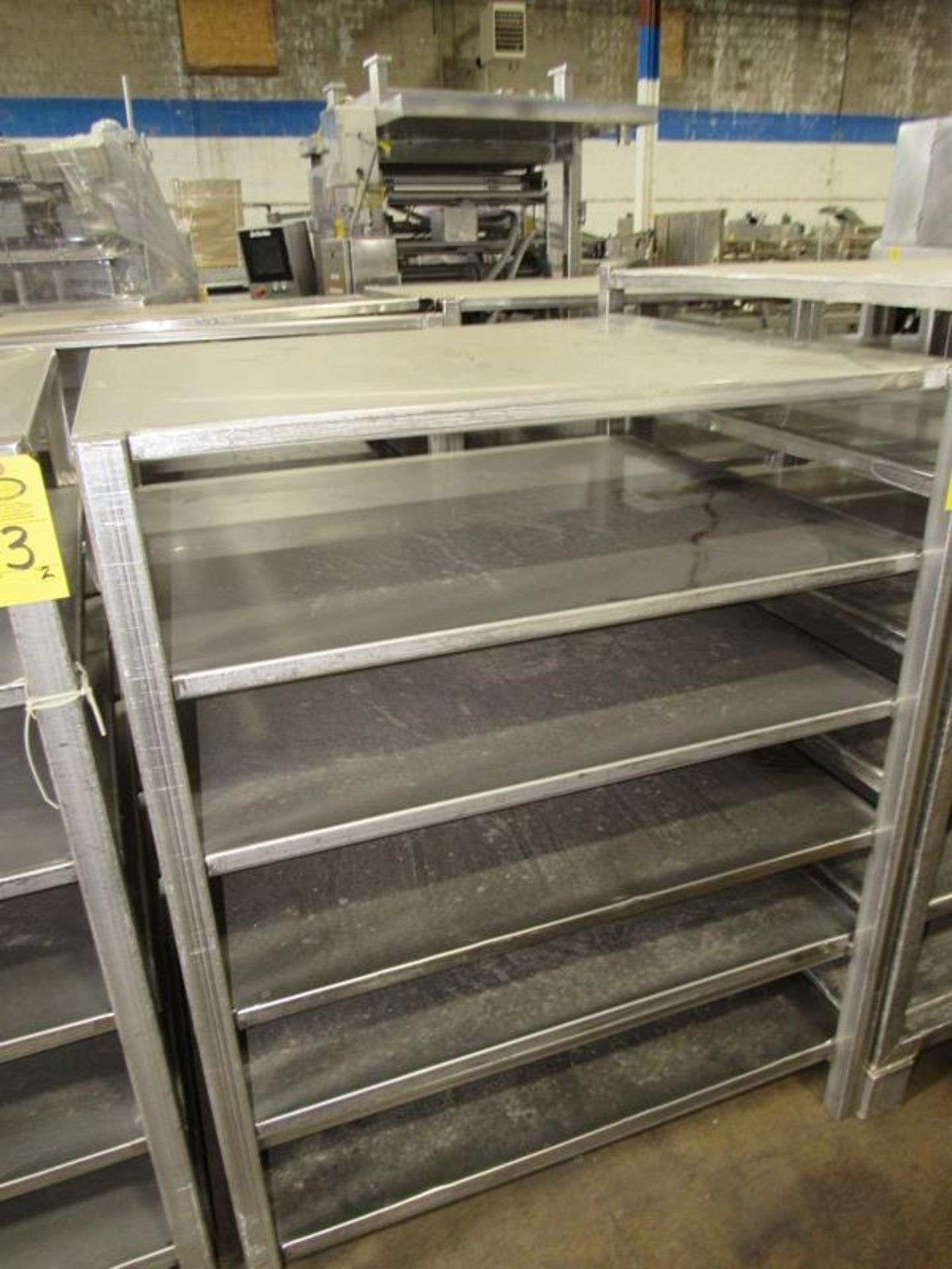 """Stainless Steel Racks, 44"""" W X 48"""" L X 5' T, 6 shelves spaced 9"""" apart (Equipment must be removed by"""