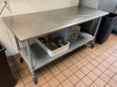 """DESCRIPTION: 72"""" X 30"""" STAINLESS TABLE W/ GALV UNDER SHELF AND CASTERS. ADDITIONAL INFORMATION NO CO"""