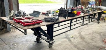 DESCRIPTION 20' STEEL WORK TABLE W/ STEEL FRAME ON CASTERS ADDITIONAL INFORMATION CONTENTS ON TABLE