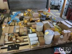 Lot of (4) pallets with assorted Caterpillar parts including starter, alternator, fuel, oil and