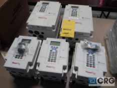 Lot of (5) Allen Bradley Power Flex 70 variable frequency drives, (3) 5 HP and (2) 10 HP (Loading