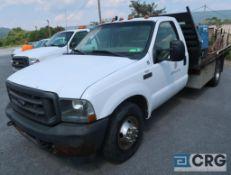 2003 Ford F350 XL Superduty flatbed truck, regular cab, 2WD, 5.4L Triton engine, AT, gas, 144 in.