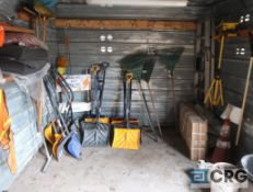 Lot of garden tools including shovels, rakes, brooms, lights, snow shovels, and (2) wheelbarrows (