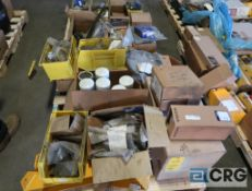Lot of (2) pallets of Volvo assorted parts including fuel, oil, and air filters, electrical harness,
