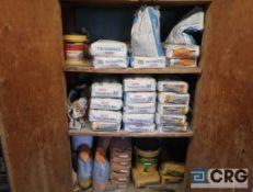 Lot includes (1) pallet concrete cement mix bags, concrete outside, and bags of sand (Shop 1)