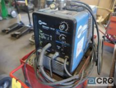 Miller 130XP wire welder with cart, extra parts and cart, s/n LA246166 (Maintenance Shop)