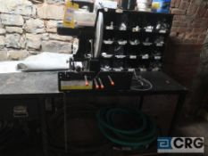 Lot of miscellaneous items including (1) hydraulic work bench, (1) cut off saw, (1) Eagle 4 gal.
