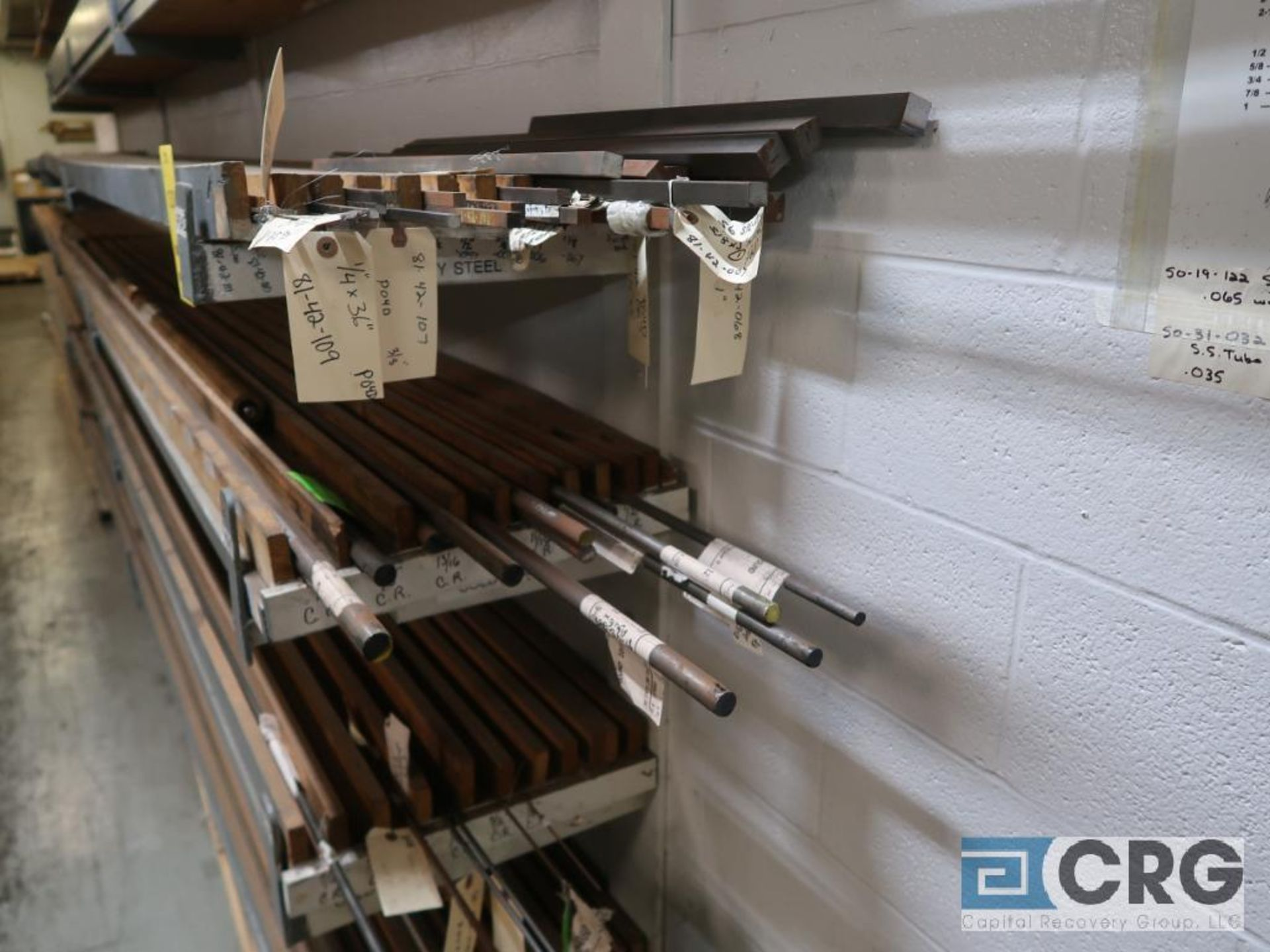 Wall mount rack with cold roll shaft, stainless tubing, key steel, and conduit pipe (Store - Image 4 of 7
