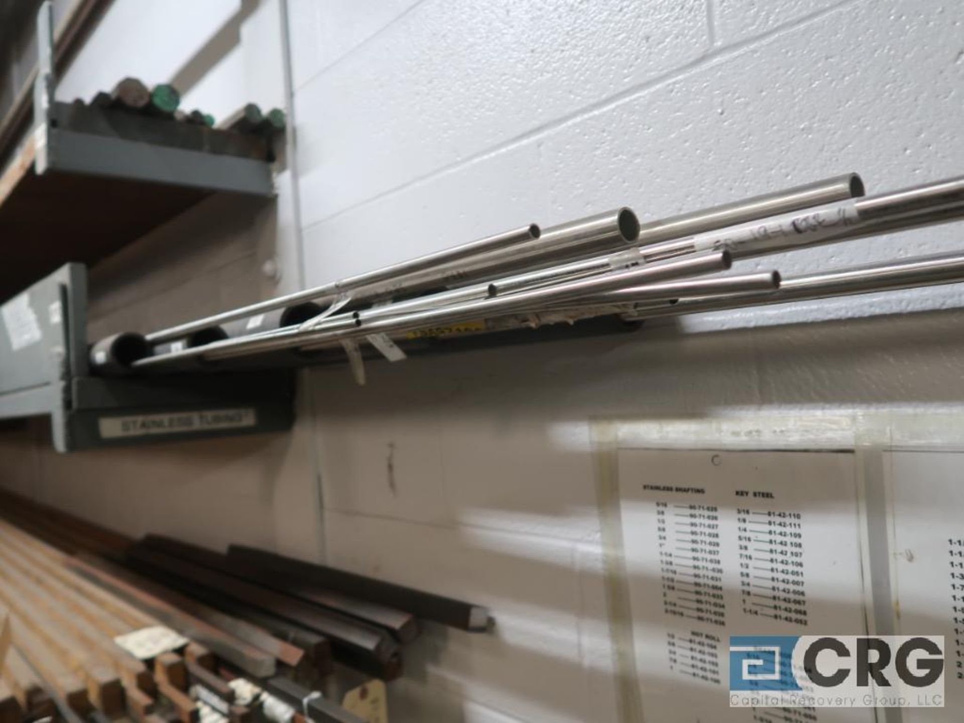 Wall mount rack with cold roll shaft, stainless tubing, key steel, and conduit pipe (Store - Image 3 of 7