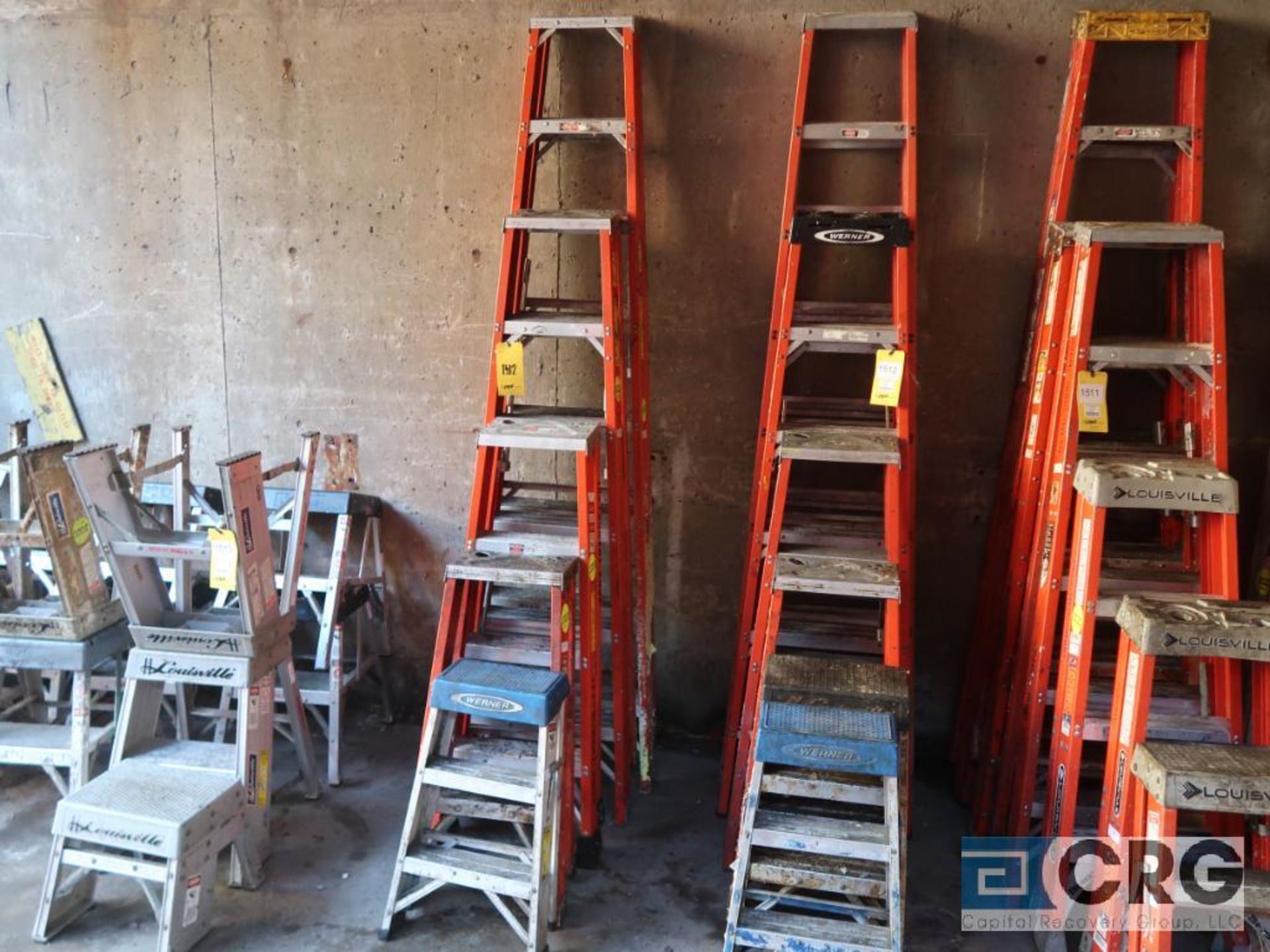 Lot of (11) ladders including (2) 7 step, (2) 5 step, (2) 3 step, and (5) 2 step (Stores Area)