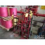 Lot of (6) hand trucks, and (2) barrels/drums (Stores Area)