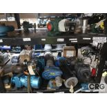 Lot of assorted parts on (4) sections and on wood shelving including motor, guards, housing, pump