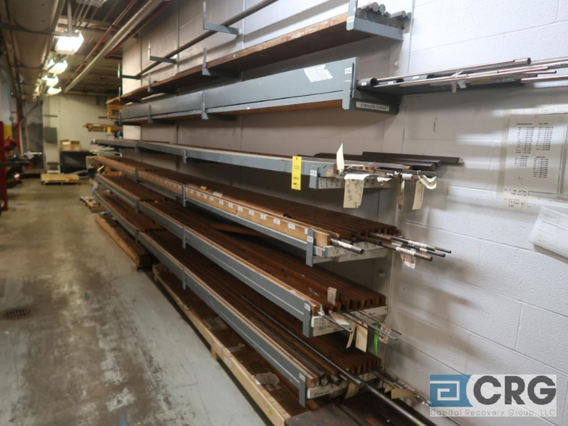 Wall mount rack with cold roll shaft, stainless tubing, key steel, and conduit pipe (Store - Image 2 of 7
