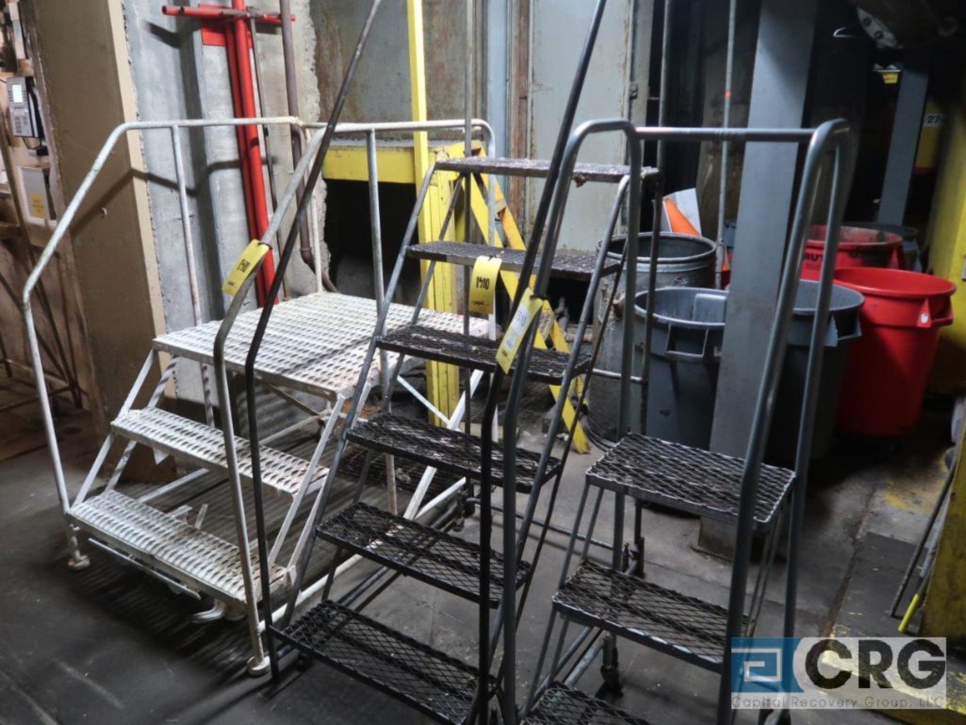Lot of (7) safety ladders including (2) 3 step, (1) 2 step with work platform, and (3) 4 step (