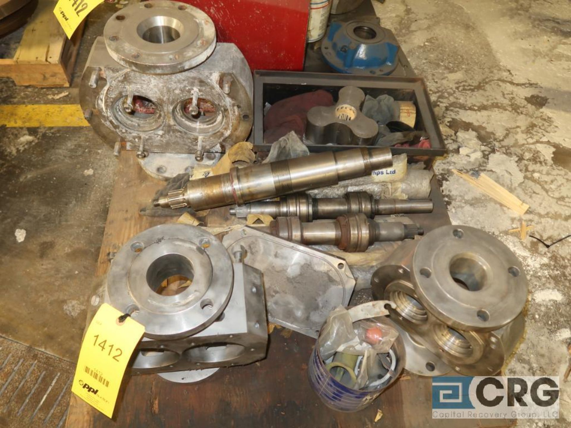 Lot of assorted Waukesha pump parts on (2) pallets including impellers, gaskets, and sen. Shafts (