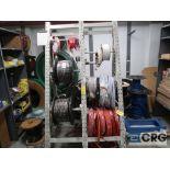 Lot of assorted hoses including racks(Store Basement)