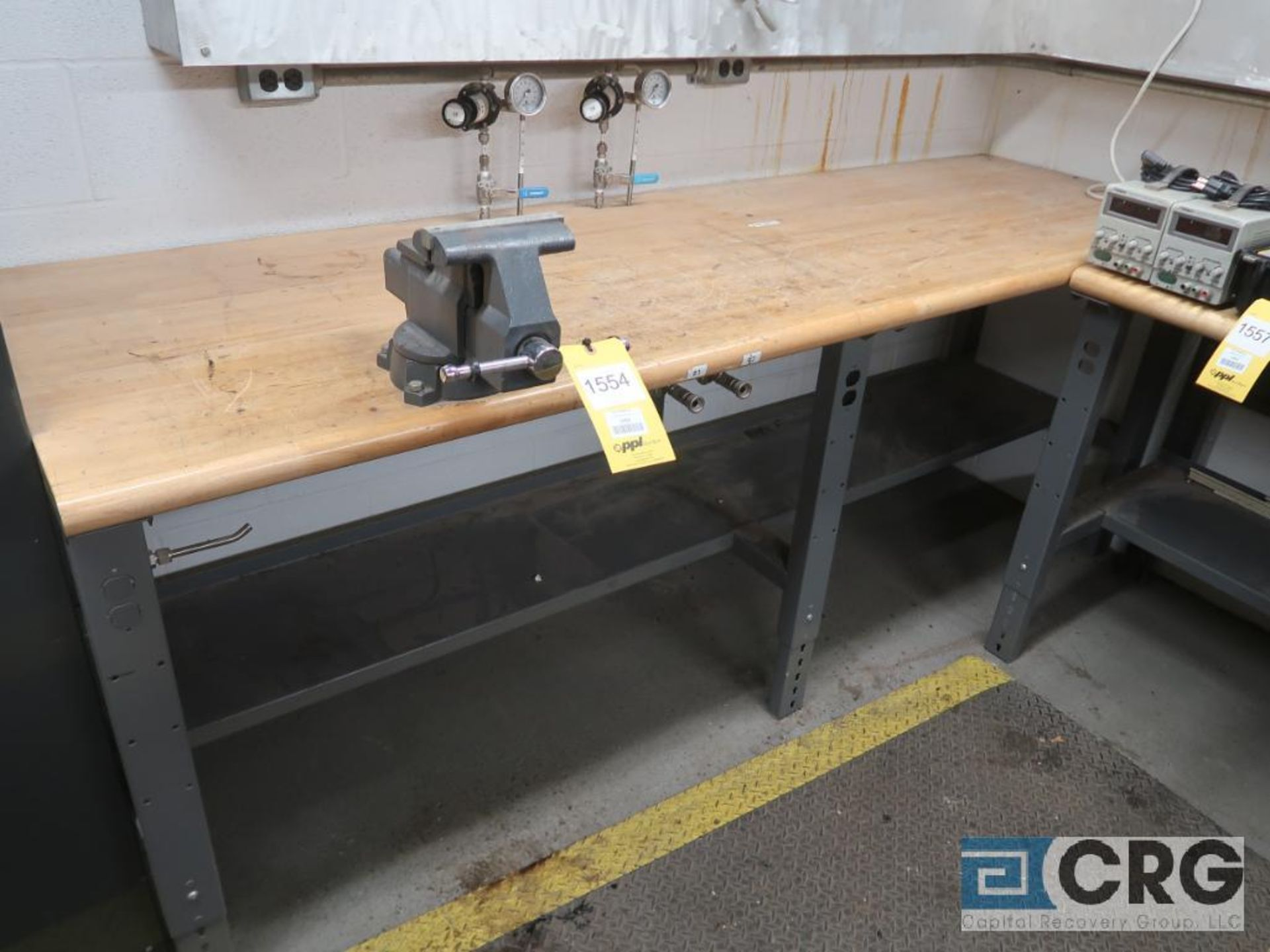 Lot of (3) work benches including (1) 8 ft. x 30 in. with 6 in. vise mounted, (1) 6 ft. 30 in.