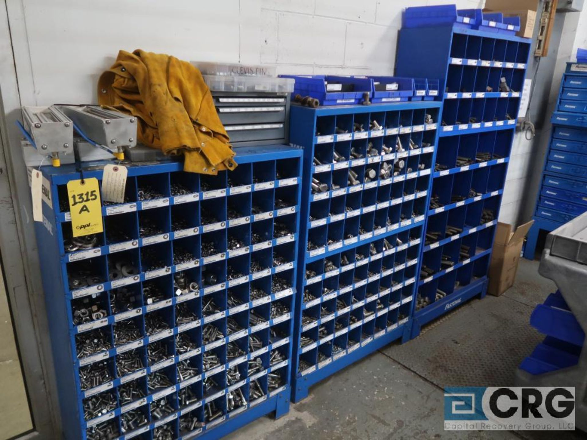 Nut and bolt 4 drawer parts bin with parts including wire, nuts, springs, cotter pins, and bin