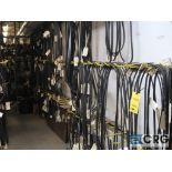 Lot of assorted V-belts hanging, and (6) metal shelving sections-CONTENTS ONLY (Store Basement)